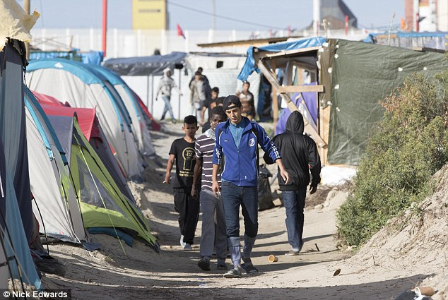 On Katie's visit to the Jungle in Calais she was tear gassed and her photographer was mobbed. Above, some of the camp's younger residents