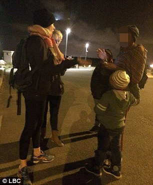Katie talks to Allam and her two young children in the Jungle in Calais