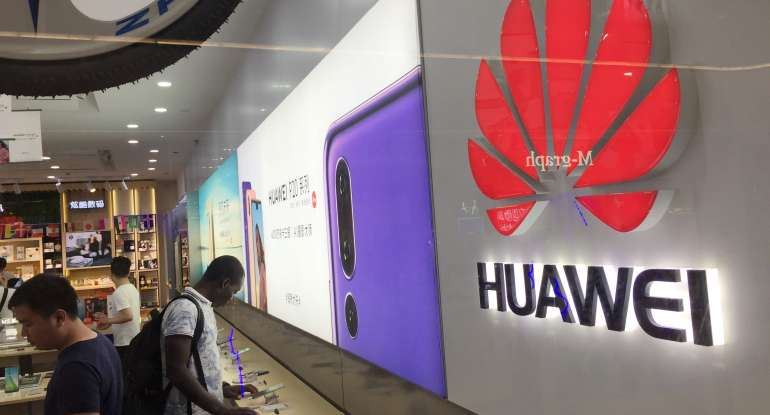 Customers shop at a Huawei store in china